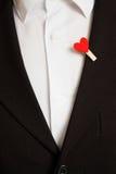 Corazón rojo en un traje Fotos de archivo libres de regalías