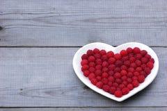 Corazón rojo hecho de la frambuesa Fotos de archivo libres de regalías
