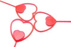 Corazón rojo plástico tres Fotos de archivo libres de regalías