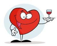 Corazón rojo que sirve un vidrio de vino rojo Imágenes de archivo libres de regalías