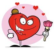Corazón rojo romántico que sostiene rosas rosadas Foto de archivo libre de regalías