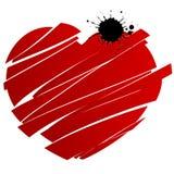 Corazón rojo salpicado y roto Imagenes de archivo