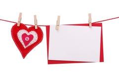 Corazón rojo y tarjeta en blanco Imágenes de archivo libres de regalías