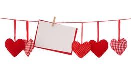 Corazón rojo y tarjeta en blanco Fotos de archivo