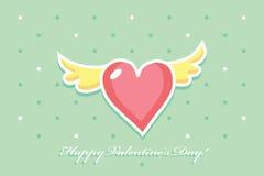 Corazón rosado con las alas amarillas en un fondo verde Foto de archivo libre de regalías