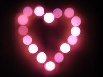 Corazón rosado de luces borrosas Imágenes de archivo libres de regalías