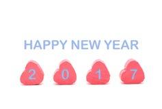 Corazón rosado en el fondo blanco con la cuesta del azul de la Feliz Año Nuevo 2017 Foto de archivo libre de regalías