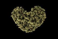 Corazón verde hecho de la marijuana Fotos de archivo libres de regalías