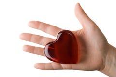 Corazón vidrioso en la palma 2 de la mujer Foto de archivo libre de regalías