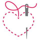 Corazón y aguja Imagenes de archivo