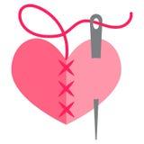 Corazón y aguja Imagen de archivo libre de regalías