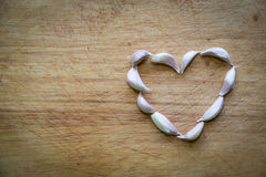 Corazón y ajo foto de archivo