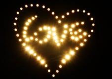 Corazón y amor abstractos de oro brillantes Foto de archivo libre de regalías