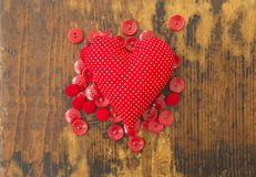 Corazón y botones rojos Fotografía de archivo