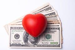 Corazón y dólares Fotos de archivo