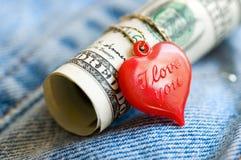 Corazón y dinero Imagen de archivo