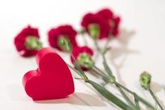 Corazón y flores Imagenes de archivo