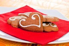 Corazón y galletas formadas flor Imágenes de archivo libres de regalías