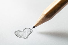 Corazón y lápiz Foto de archivo libre de regalías