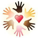 Corazón y manos Imagenes de archivo