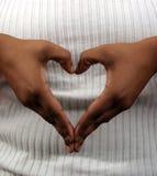 Corazón y manos Imágenes de archivo libres de regalías