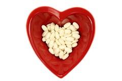 Corazón y medicinas rojos brillantes Foto de archivo