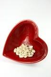 Corazón y medicinas rojos brillantes Imagen de archivo