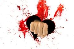 Corazón y puño rojos en él Imagen de archivo
