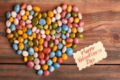 Corazón y tarjeta coloridos del caramelo Imagen de archivo
