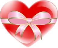 Coraz?n rojo atado con la cinta rosada Imagen de archivo libre de regalías