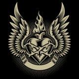 Corazón ardiente con alas con las espinas Foto de archivo libre de regalías