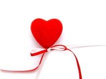 Corazón con un arqueamiento Imagenes de archivo