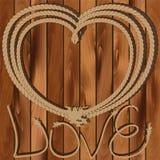 Corazón de la cuerda en un fondo de madera Fotos de archivo