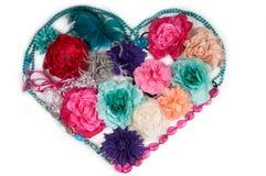 Corazón de la flor hecho de los accesorios de las señoras Foto de archivo