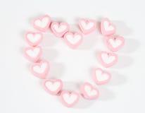Corazón de la palabra de los dulces rosados aislados Fotos de archivo