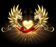 Corazón de oro con las alas de oro Fotografía de archivo