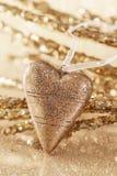 Corazón de oro de la Navidad Imagenes de archivo