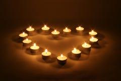 Corazón de velas Imagen de archivo libre de regalías