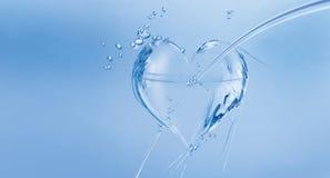 Corazón del agua con la flecha Imagen de archivo