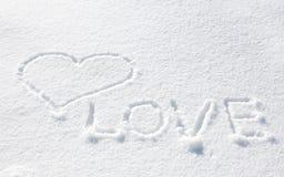 Corazón en la nieve Fotos de archivo libres de regalías