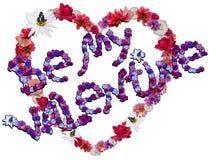 Corazón hermoso con la leyenda hecha de diversas flores Imagen de archivo