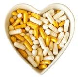 Corazón por completo de píldoras Foto de archivo libre de regalías