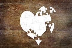 Corazón quebrado como rompecabezas Fotografía de archivo