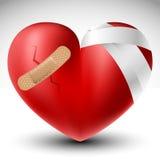 Corazón quebrado con el vendaje Imagen de archivo