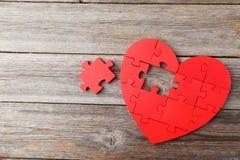 Corazón rojo del rompecabezas Foto de archivo libre de regalías