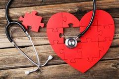 Corazón rojo del rompecabezas Imágenes de archivo libres de regalías