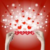 Corazón rojo en las manos Foto de archivo libre de regalías