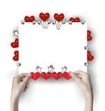 Corazón rojo en las manos Fotos de archivo