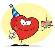 Corazón rojo que sostiene una torta de cumpleaños Foto de archivo libre de regalías