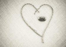 Corazón y alma en la arpillera Imagen de archivo libre de regalías